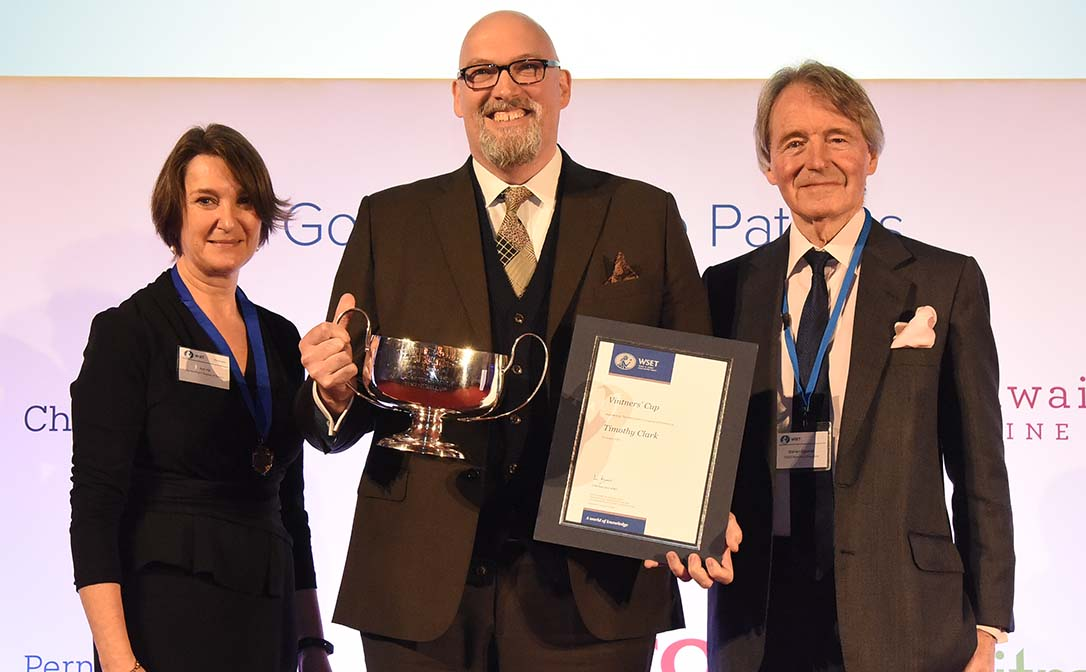 Timothy Clark being presented with the Vinters' Cup. (Left to right: Ann Hill, Worshipful Company of Vintners; Timothy Clark, prize winner; Steven Spurrier, WSET Honorary President)