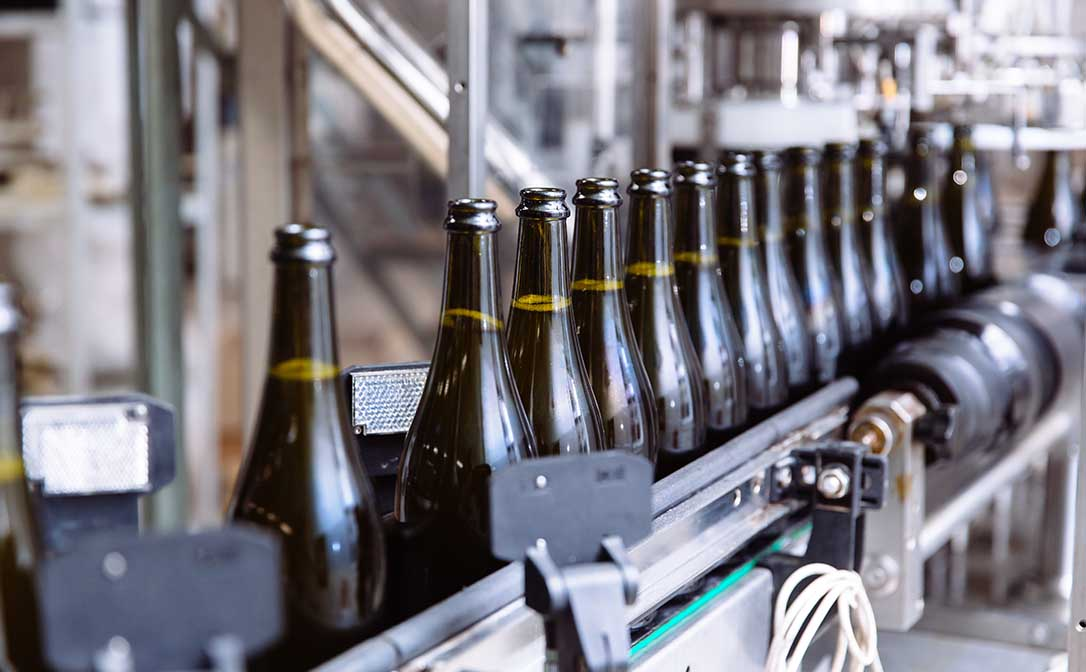 Wine bottles on an automatic conveyor